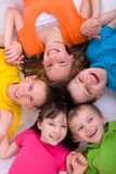 Five Smiling Children. In bright colors in a circle stock images