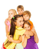 Five smiling hugging kids Stock Photo