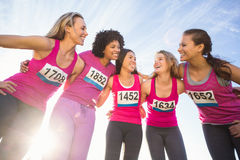 Five smiling runners supporting breast cancer marathon Royalty Free Stock Image