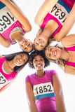 Five smiling runners supporting breast cancer marathon Stock Photos