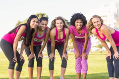 Five smiling runners supporting breast cancer marathon Stock Images