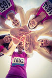 Five smiling runners supporting breast cancer marathon Royalty Free Stock Images
