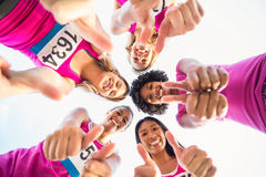 Five smiling runners supporting breast cancer marathon Royalty Free Stock Photos