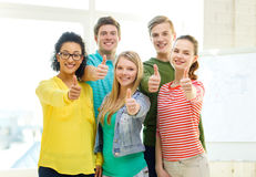 Five smiling showing thumbs up at school Royalty Free Stock Photography