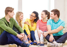 Five smiling teenagers having fun at home Stock Photo