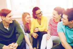 Five smiling teenagers having fun at home Stock Images