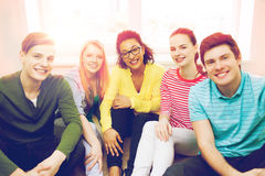 Five smiling teenagers having fun at home Royalty Free Stock Photography