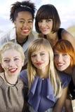 Five smiling women. Five smiling women looking to camera stock image