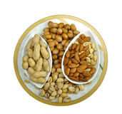 Five sorts of nuts in plate. Five sorts of nuts in colorous plate royalty free stock image