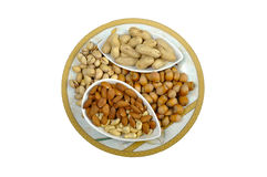 Five sorts of nuts in plate. Five sorts of nuts in colorous plate stock photo