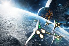 Five space ships flying to the collapsing planet. Elements of this image furnished by NASA Royalty Free Stock Photos