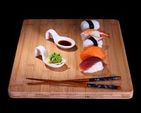 Five species of fish sushi on bamboo board Stock Photos