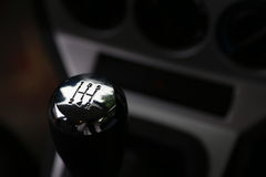 Five speed gear shift in chrome. A five gear speed shift knob shown inside a brand new car in Canada royalty free stock images