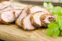 Five Spice Duck. Chinese style roast duck breasts on a chopping board Royalty Free Stock Photography