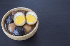 Five spice pork and egg stew with wooden kitchenware copyspace o Stock Images