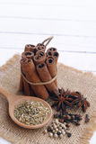 five spice on wooden background. Royalty Free Stock Photo