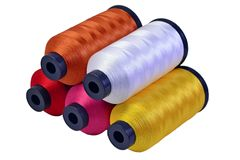 Five spools of threads Stock Photo