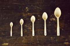 Five spoons on the table stock image