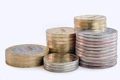 Five stacks of coins. Against white background Stock Image