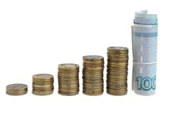 Five stacks of coins and banknotes. Isolated Royalty Free Stock Image