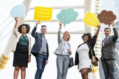 Five Standing People Holding Message Clouds stock photo