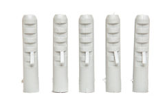 Five standing plastic dowels Stock Image