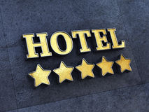 Five star hotel. Golden 5 star Hotel sign on a wall , Luxury Hotel Stock Photo