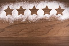 Five star product quality rating on cooking background. Top view royalty free stock photography