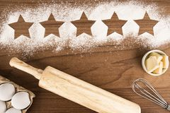 Five star product quality rating on cooking background, top view. Stock Image