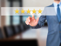 Five star rating - Businessman hand pressing button on touch screen interface. Business, technology, internet concept. Stock Photo royalty free stock image