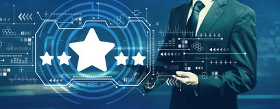 Five star rating with businessman stock image