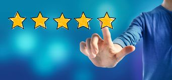 Five star rating with a man stock photography