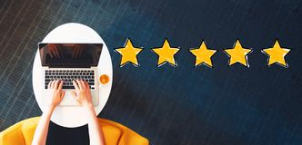 Five Star Rating with person using a laptop royalty free stock photos