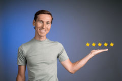 Five star rating or ranking, benchmarking concept. Man assesses service, hotel, restaurant. 5 star rating or ranking, benchmarking concept on blue background royalty free stock image