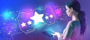 Five star rating with woman using a tablet. Five star rating with business woman using a tablet computer royalty free stock photos