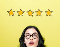 Five star rating with young woman royalty free stock images