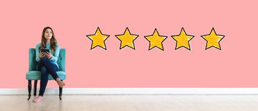 Five star rating with young woman stock image