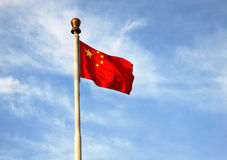 The five-star red flag under blue sky. The five-star red flag(the chinese national flag) under blue sky in the People square, Dalian, China Stock Photos