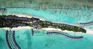 5 star resort water bungalows in Maldives with drone aerial flying view on white sand beach on tropical Royalty Free Stock Photo