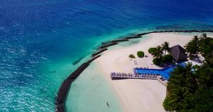 Five 5 star resort water bungalows in Maldives with drone aerial flying view on white sand beach on tropical Royalty Free Stock Photos