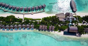 Five 5 star resort water bungalows in Maldives with drone aerial flying view on white sand beach on tropical Royalty Free Stock Images