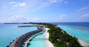V09537 five 5 star resort water bungalows in Maldives with drone aerial flying view on white sand beach on tropical Royalty Free Stock Photo