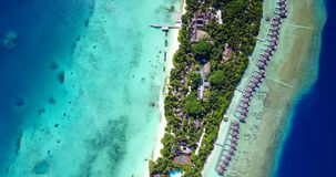 V09495 five 5 star resort water bungalows in Maldives with drone aerial flying view on white sand beach on tropical. Five 5 star resort water bungalows in Stock Photos