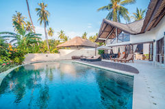 Five Star Villa Bali. Private and beautiful beachfront villa property located in village, Bali - Indonesia with clean green garden, overlooking to the ocean and Royalty Free Stock Photos