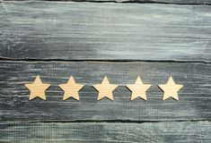 Five stars on a dark background. The concept of rating and evaluation. The rating of the hotel, restaurant, mobile application. Qu. Ality service, buyer choice royalty free stock photography
