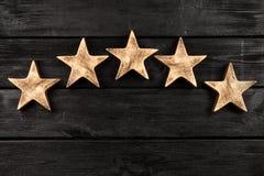 Five stars on dark background. Five stars sign on dark background Stock Photos
