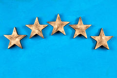 Five stars on dark background. Five stars sign on blue background Royalty Free Stock Photography
