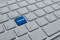 Five stars on modern computer keyboard button, Increase rating, Stock Image