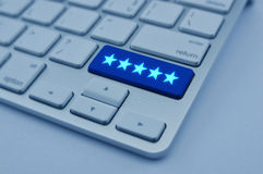 Five stars on modern computer keyboard button, Increase rating, Royalty Free Stock Photography