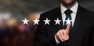 Five stars rating. With a businessman touching screen, concept about positive customer feedback and review royalty free stock images